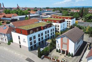 Diese Visualisierung zeigt, wie die drei Gebäude an der Heerstraße 51 aussehen sollen, wenn sie im Herbst 2022 fertig sind. Foto: Campus Heerstraße GmbH